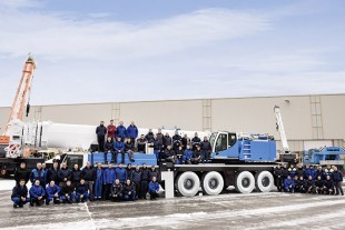 The 10,000th used crane with the repair centre team at Liebherr in Ehingen.