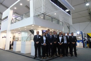 Liebherr Team in front of the booth at Perumin 2019