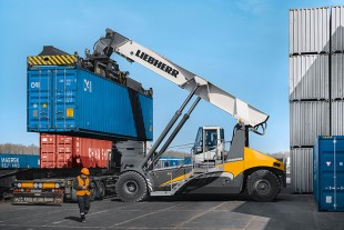 The Liebherr Reachstacker LRS 545-31 is busy handling containers in the Freight Village Kaluga, Russia.