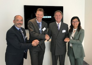 Representatives from SR Technics and Liebherr-Aerospace shaking hands after the contract signature. - © Liebherr