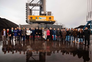 Company representatives and employees receive the new crane in Gijón, Spain
