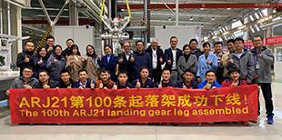 It's all thumbs up: Members of the Liebherr LAMC Aviation (Changsha) team celebrate the delivery of the 100th ARJ21 landing gear strut.