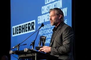 Peter Mayr, managing director of Liebherr USA, Co. accepts the AED Foundation Partner Award in Chicago on January 14, 2020.