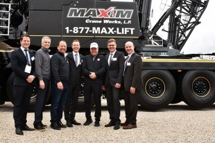 Liebherr USA, Co. mobile crane division leaders and the leadership of Maxim Crane Works following the handover of an LTM 1650-8.1 mobile crane on the first day of Conexpo 2020.