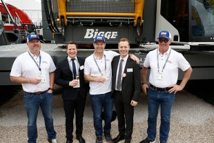 Liebherr USA, Co. mobile crane division leaders and the leadership of Bigge Crane and Rigging Co. following the handover of an LR 1800-1.0 crawler crane on the first day of Conexpo 2020.