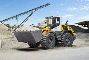 A new Liebherr L 526 wheel loader loading bulk materials.