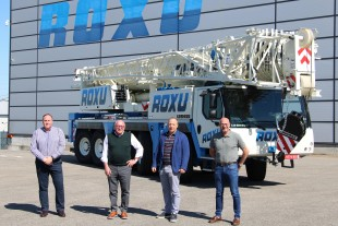 Crane handover in Spain: from left to right: Marco García, José Manuel García, (both from Grúas Roxu), Tobias Böhler (Liebherr Ibérica, S.L.), Daniel García (Grúas Roxu).