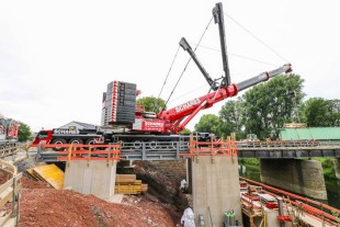 Supported on concrete foundations specially made for the hoists, the cranes take the strain off the heavy transport vehicles as they move into position to prevent damaging the existing bridge.