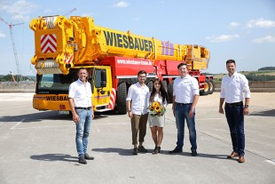 Great-grandchildren – members of the fourth generation of the family-run company taking delivery of their third Liebherr LTM 1750-9.1 mobile crane.