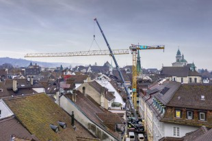 Seems to be stuck - the LTM 1110-5.1 from Zaugg, who is dismantling a Liebherr construction crane in a narrow alley in the old town of Solothurn, Switzerland.