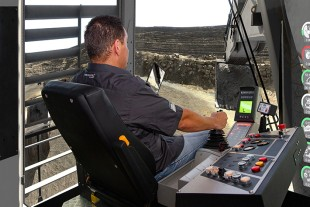 Operator in the ThoroughTec CIBERMINE simulator for the Liebherr R 9350 mining excavator