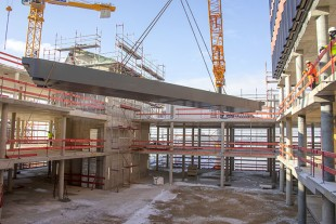 The 450 tonne crane carefully threads the prefabricated staircases and other components into the building.
