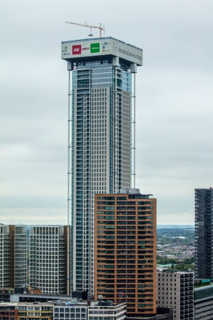 A rather unusual assignment: A Liebherr 34 K fast-erecting crane at one of Europe's tallest residential towers in Rotterdam.
