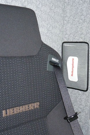 The Liebherr rescue seat is located behind the driver's seat.