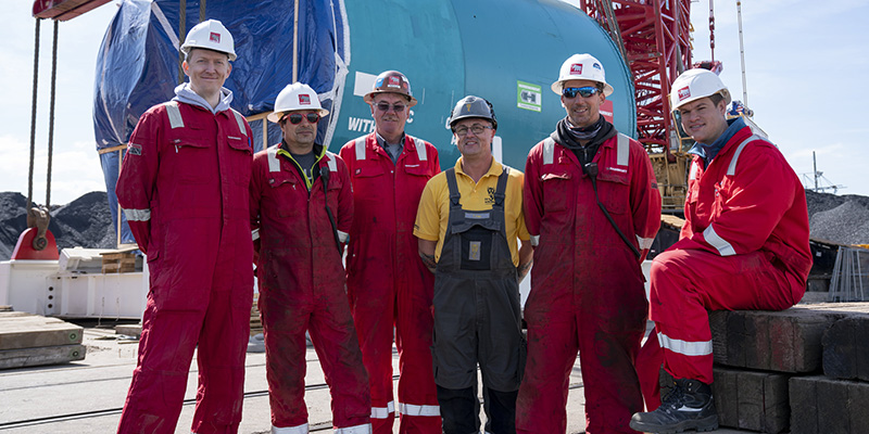 Group photograph in front of the drilling machine –